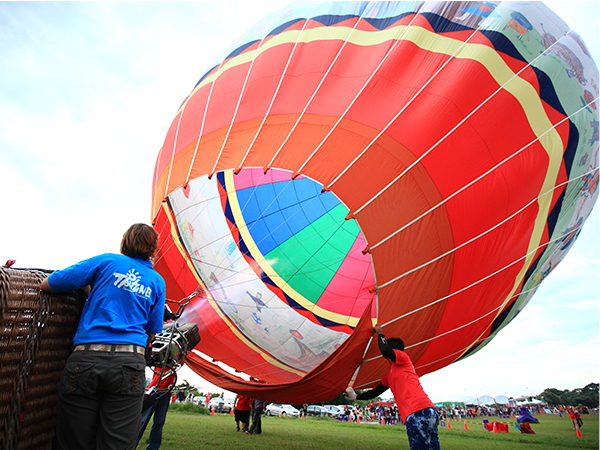 Heating up the air inside the balloon with the burner